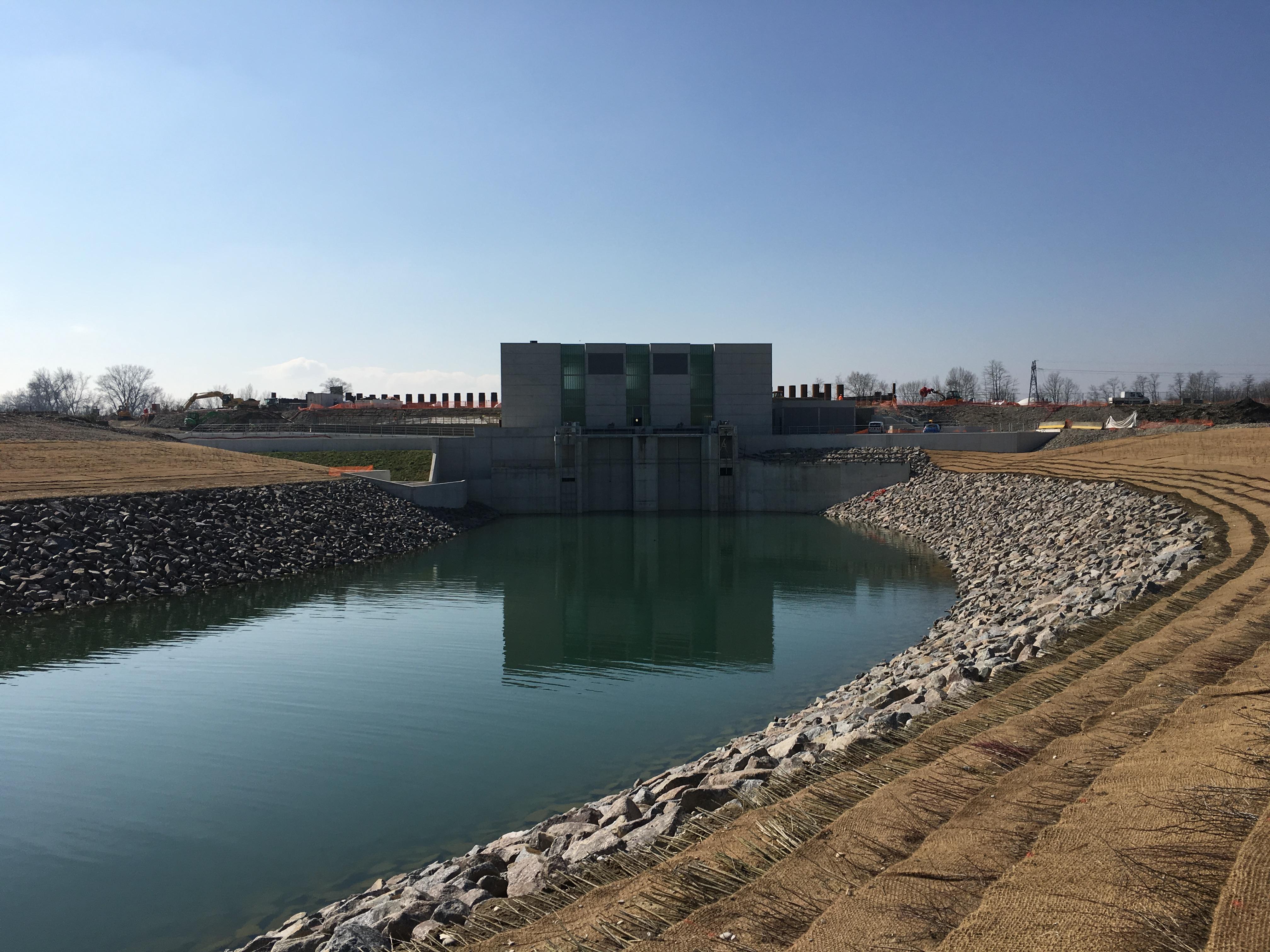 EDF - CIH, BARRAGE de KEMBS (68) Construction d'une nouvelle centrale de turbinage et restitution et des passes à poissons, Implantation sur l'île du Rhin entre le Grand Canal d'Alsace et le vieux Rhin